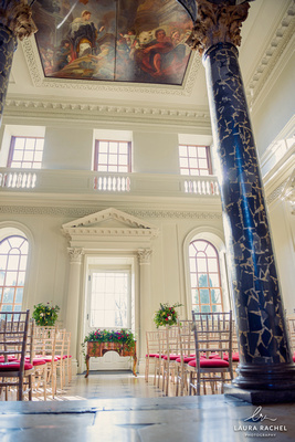 Photo of the ceremony room viewing the chairs, registrar's desk and the painting on the ceiling