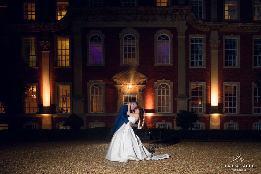 bride and groom together outside Chicheley Hall at night time