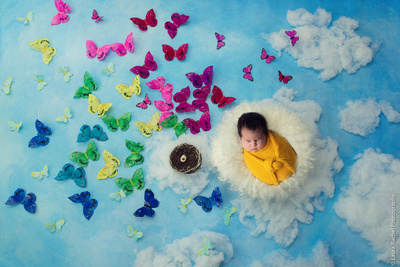 Rainbow Baby with butterflies. A special image for the parents.