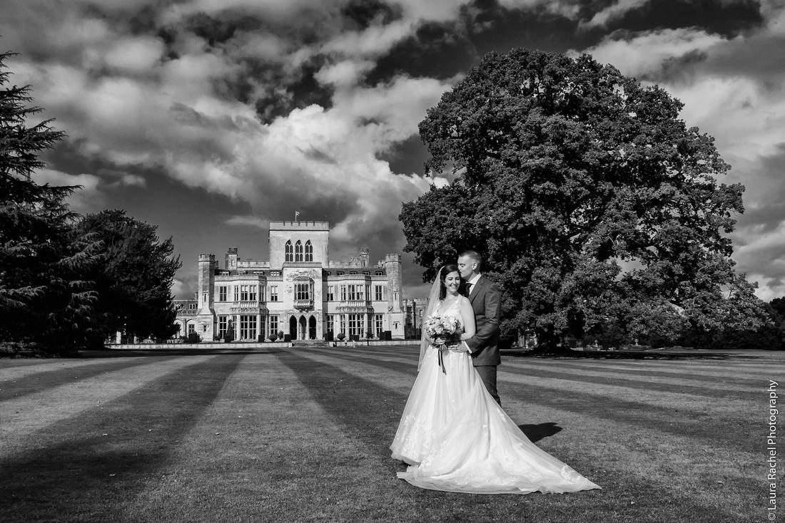 Florist flowers, wedding dress, suit, bride and groom outside Ashridge House getting married
