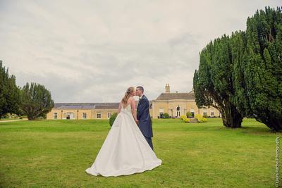 Bride and Groom kissing outside Barton Hall