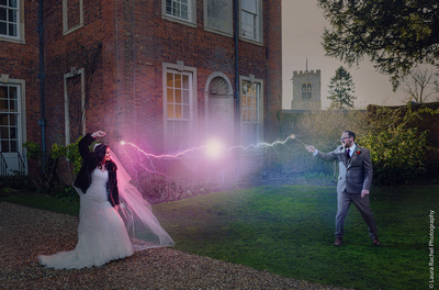 Couple posing for a Harry Potter themed photo, using lightning photoshopped in. At Chicheley Hall