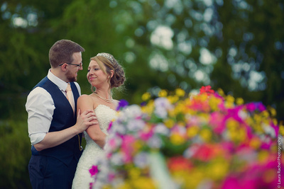 Bride and Groom with flowers in the foreground