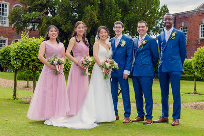 Bride and Groom with their bridesmaids and groomsmen outside Chicheley Hall